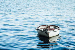 Brown and White Boat in the Middle of the Ocean Royalty Free Stock Images