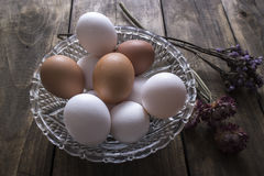 Brown and white chicken eggs in glass bowl Royalty Free Stock Image