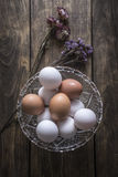 Brown and white chicken eggs in glass bowl Stock Photography