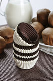 Brown and white cupcake cases Royalty Free Stock Photos
