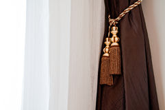 Brown and White curtain with the window lighting Stock Photography