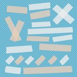 Brown and white different size adhesive, sticky, scotch tape, paper pieces on blue squared background. Stock Photos