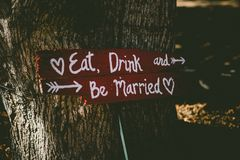 Brown and White Eat, Drink and Be Married Signage Stock Photography