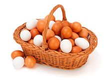 Brown and white eggs in basket Stock Image