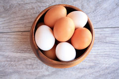 Brown and white eggs in brown bowl Royalty Free Stock Images