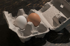 Brown and white eggs in container Royalty Free Stock Image