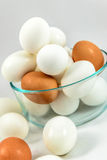 Brown and white eggs. In a glass bowl Stock Images
