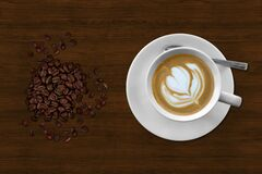 Brown and White Espresso in White Coffee Mug Beside Coffee Beans Royalty Free Stock Photos