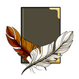 Brown and white feathers on a book Stock Image