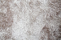 Brown an white fur carpet background Royalty Free Stock Photo