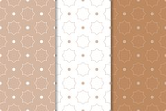Brown and white geometric ornaments. Set of seamless patterns. For web, textile and wallpapers Stock Photography