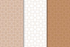 Brown and white geometric ornaments. Set of seamless patterns. For web, textile and wallpapers Royalty Free Stock Images