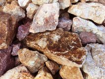 Brown white and grey rocks Royalty Free Stock Photos