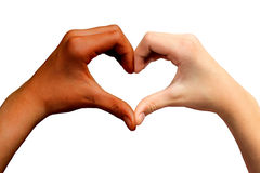 Brown and white hands in heart shape. Brown and white hands together creating heart shape stock images