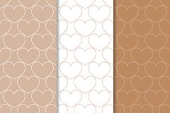 Brown and white hearts as seamless patterns. Romantic vertical backgrounds. Vector illustration royalty free illustration