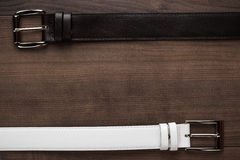 Brown and white leather belts Stock Image