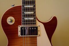 Brown and White Les Paul Guitar Stock Photo