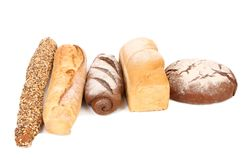 Brown and white loafs of bread. Stock Images