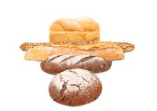 Brown and white loafs of bread. Royalty Free Stock Photo