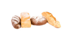 Brown and white loafs of bread. Stock Photos
