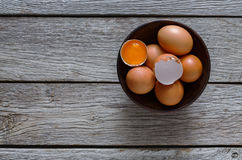 Brown and white organic eggs in bowl on wood background Stock Photo