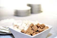Brown and white refined sugar in square bowl  Royalty Free Stock Photography