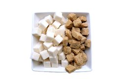 Brown and white refined sugar in square bowl isolated Stock Photography
