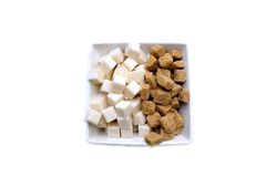 Brown and white refined sugar in square bowl isolated Stock Images