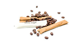 The brown and white sugar with coffee bean seed on white backgro Royalty Free Stock Photo