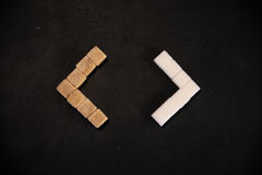 Brown and white sugar cubes Stock Photos