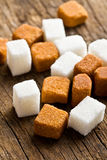 Brown and white sugar cubes Royalty Free Stock Photo