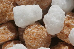Brown and White Sugar Lumps. In a bowl, close up Stock Photo