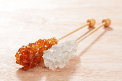 brown and white sugar on a sticks. Royalty Free Stock Photos