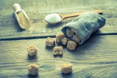 Brown and white sugar on the wooden background Royalty Free Stock Images
