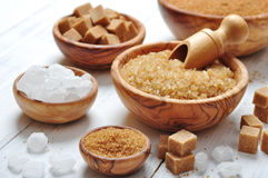 Brown and white sugar. In wooden bowls closeup Royalty Free Stock Images