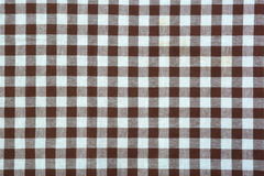 Brown and white tablecloth background. Stock Photos
