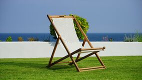 Brown and White Wooden Lounger Royalty Free Stock Images