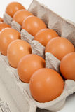 Brown whole eggs in a carton Stock Photo