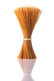 Brown Whole-Wheat Spaghetti Pasta on Isolated White Background Royalty Free Stock Photo