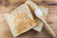 Brown whole wheat toast with sweet white jam on spoon Stock Photography