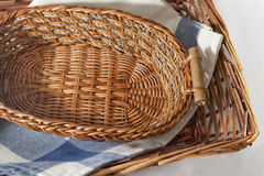 Brown wicker basket. With a blue gingham cloth for table appointments Stock Image