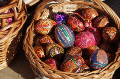 Brown wicker basket with colorful Easter eggs Royalty Free Stock Image