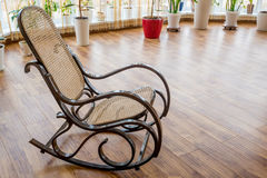 Brown wicker rocking chair Stock Photography