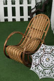 Brown wicker rocking chair is standing Stock Images