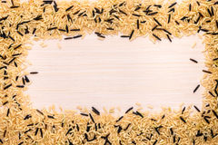 Brown and wild mixed rice framed on a wooden Stock Photography