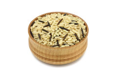 brown and wild rice in a wooden dish Royalty Free Stock Photos