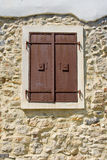 Brown window. Old brown metal window on the stone wall stock photography