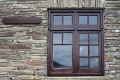 Brown window frame on a brick wall Royalty Free Stock Photos
