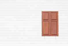 Brown window on white wooden wall background Royalty Free Stock Photos