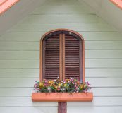 Brown window wooden with flower decoration Stock Photography